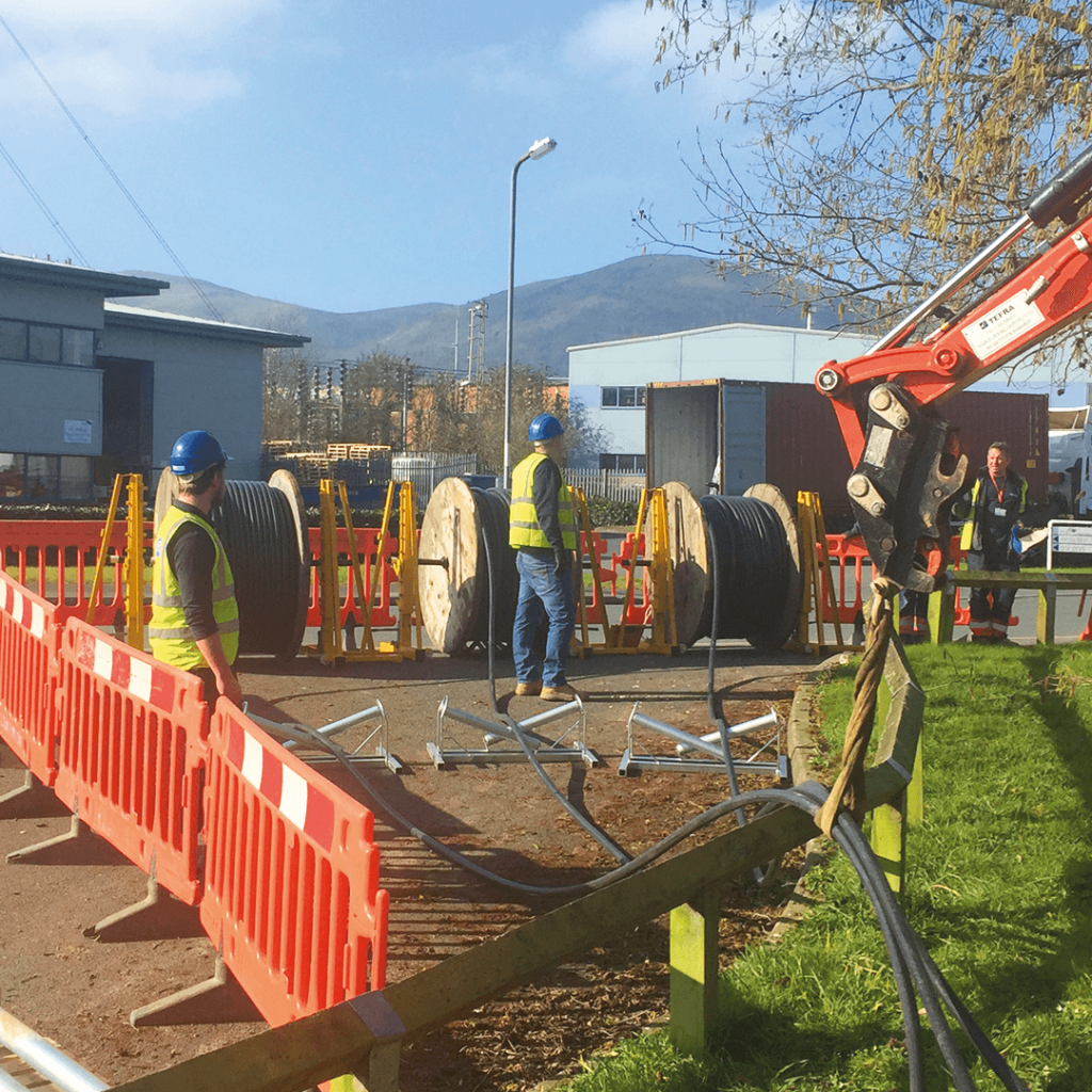 Commercial cable reels being installed onto a project