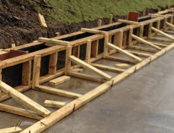 rectangle image of wooden frame being installed on civils project